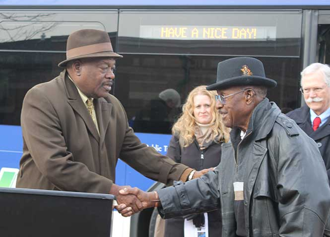 Hines & Sims - Citilink Board Member & City Councilman Glynn Hines shaking hands with Fort Wayne's first African-American bus driver Louis Sims. In the background are Citilink Board Members Sherese Fortriede & Fred Lanahan.