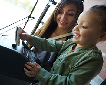 Mother and daughter using bus fare